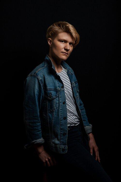pic of Yves Rees light coloured hair denim jacket white shirt thin black stripes