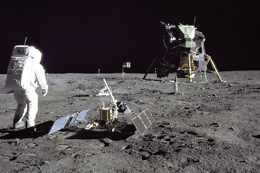 Buzz Aldrin with some of Apollo 11's scientific equipment. In the foreground is the Passive Seismic Experiment Package, and behind it is the Laser Ranging Retro-Reflector (Photo taken by Neil Armstrong, NASA)
