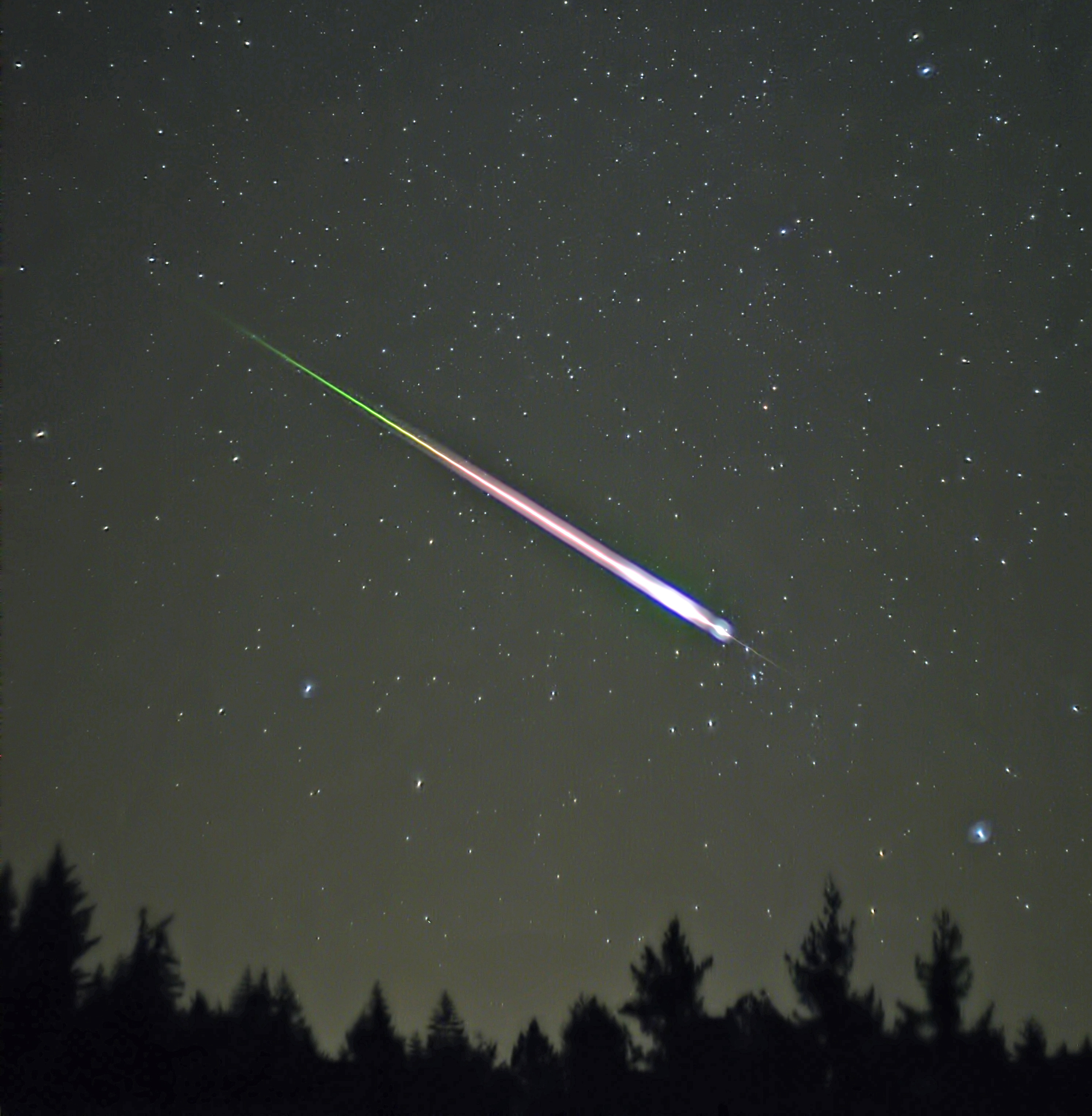 A meteor travels through earth's atmosphere