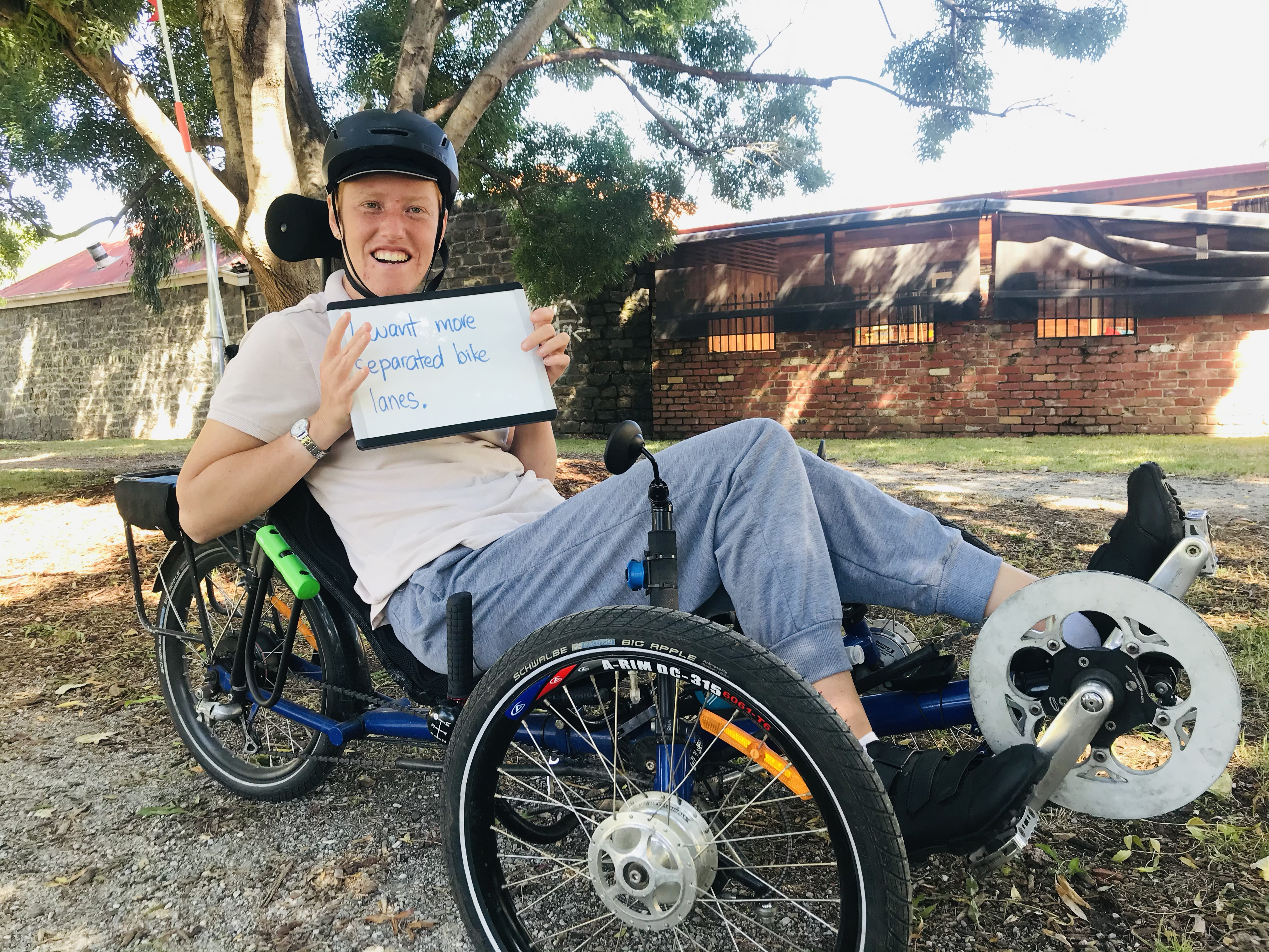 Alice Verrall on her recumbent bicycle. Protected bike lanes would allow her to shop on Sydney Road by bicycle.