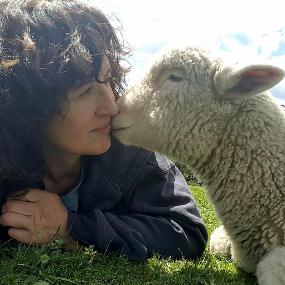 Image of Robyn with Ben, one of the lambs she raised. Image supplied by Robyn.
