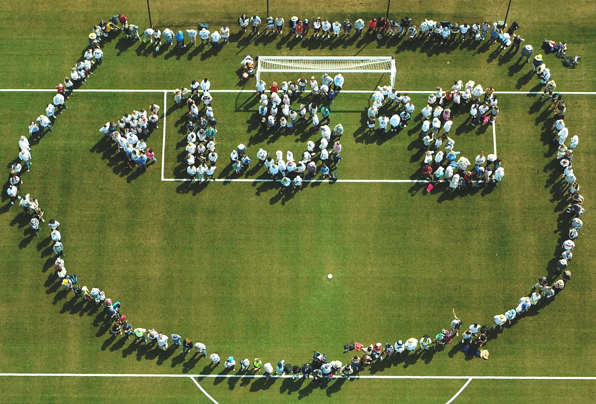 A Human sign calling for global warming to stay below 1.5 degrees