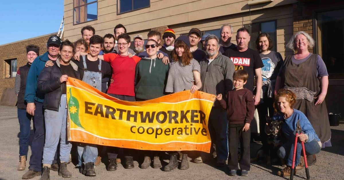 The good folks at Earthworker outside their Morwell factory with an Earthworker banner
