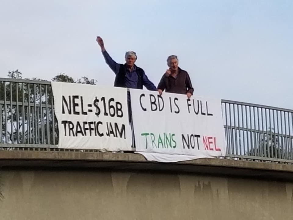 Banner Drop over Ester Freeway