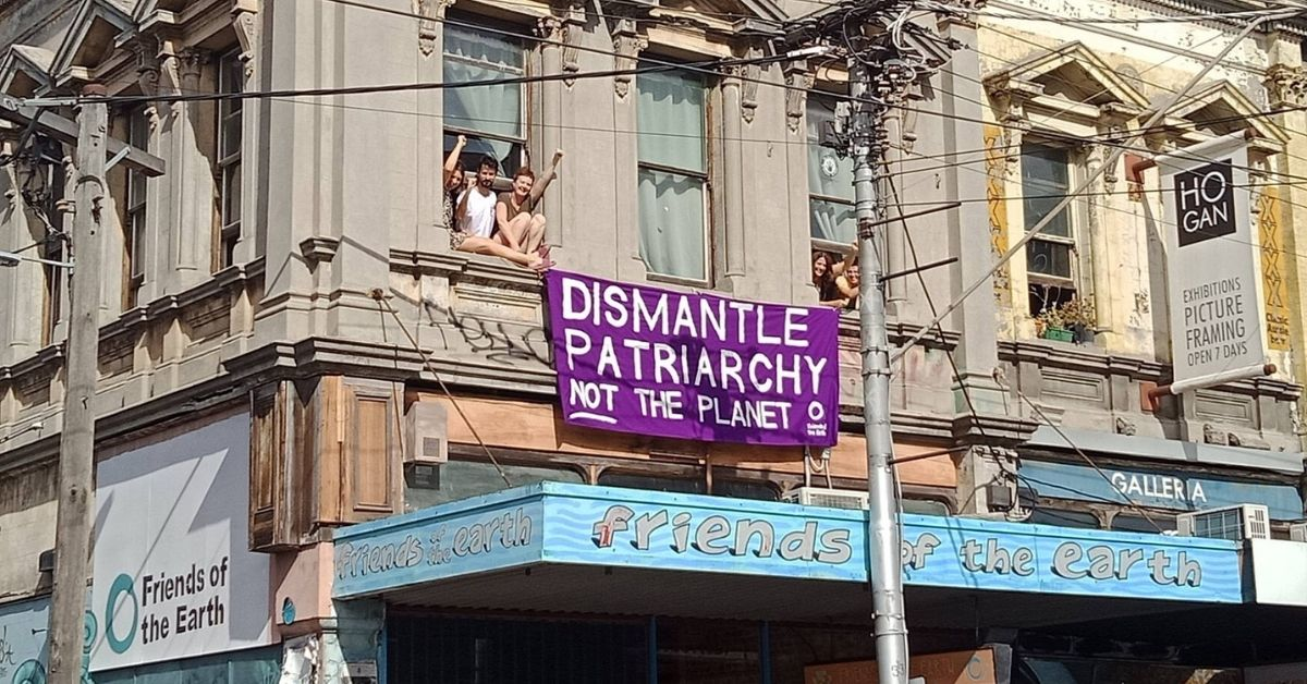 Dismantle patriarchy not the planet - banner hanging from Friends of the Earth's Smith St building
