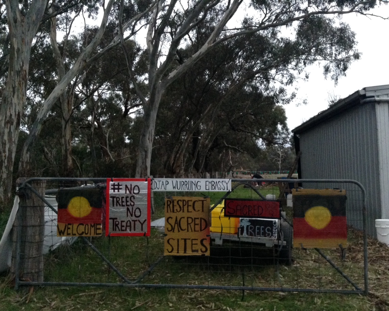Gate at front of Djabwurrung embassy, covered in protest signs