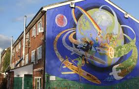 Image of a large house with mural showing people flying around the world