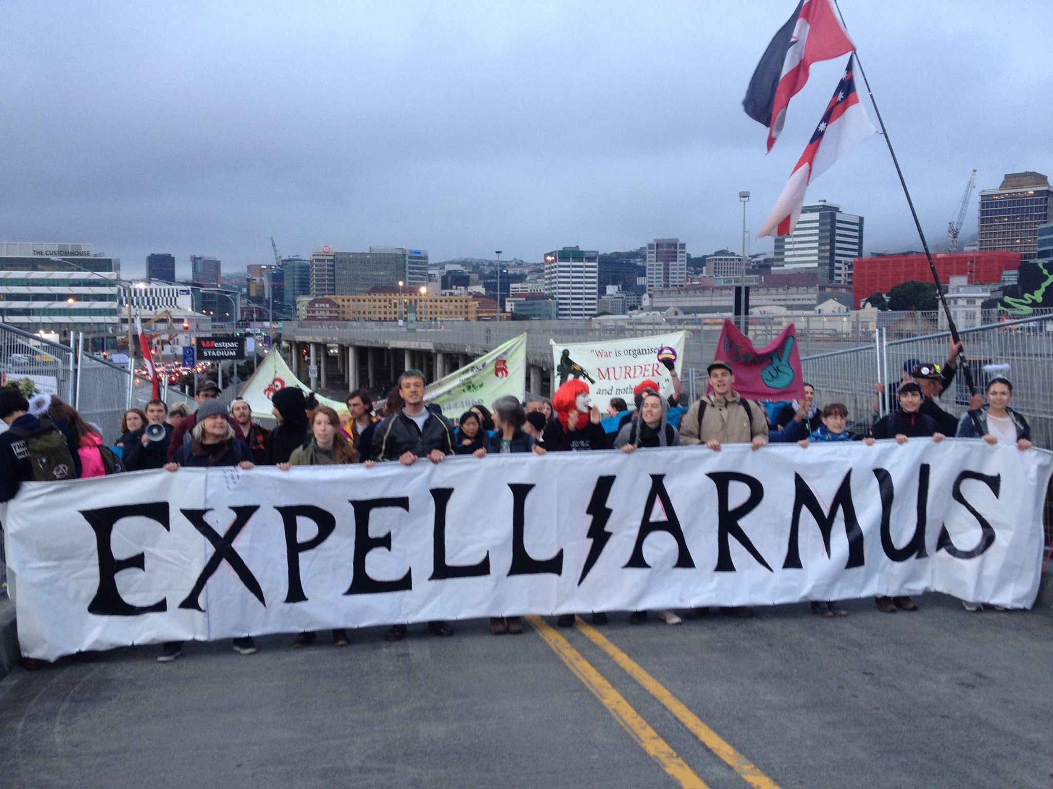 """A number of protesters holding a sign that says """"Expelliarmus!"""""""