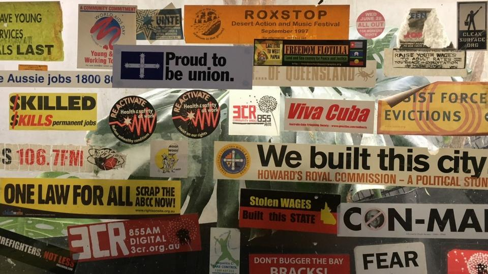 3CR kitchen window of campaign stickers about all things work and solidarity.
