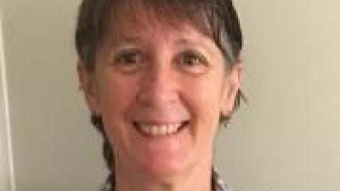 Dr Sharon Dane medium to dark hair checked shirt