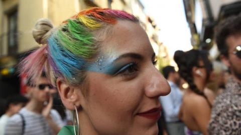 person with hair in rainbow colours