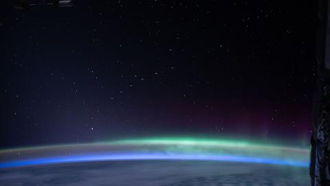 A train of Starlink satellites in low Earth orbit, as seen from the International Space Station – with bonus Aurora australis (Photo by NASA, Public domain, via Wikimedia Commons)