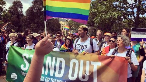 Image of Stand Out group holding rainbow flag
