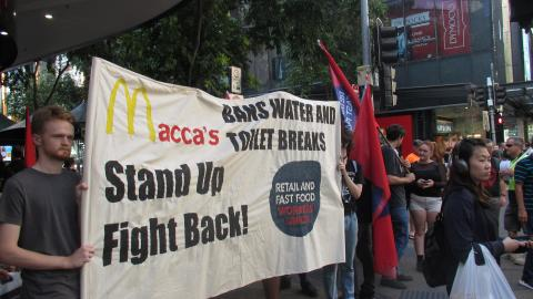 Workers protest out the front of a MacDonalds store in Brisbane