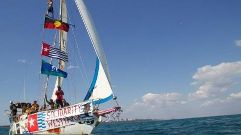 Sail boat with First Nation & West Papuan flags