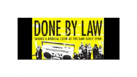 """A poster with the title """"Done by Law"""" subtitled """"taking a radical look at the law since 1980"""" with a group of people and a stereo in black and white on a yellow background"""