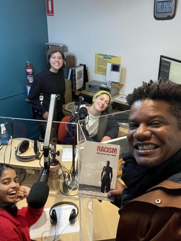Photo of Guido Melo and presenters in the 3CR studio