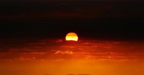 Sunset during last summer's bushfires resembling Aboriginal flag