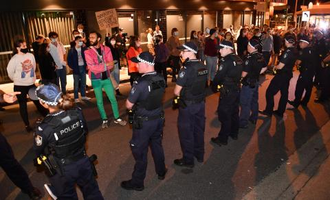 Protesters face off against the police line at the Kangaroo Point blockade