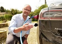 Robert Llewellyn plugging in electric vehicle