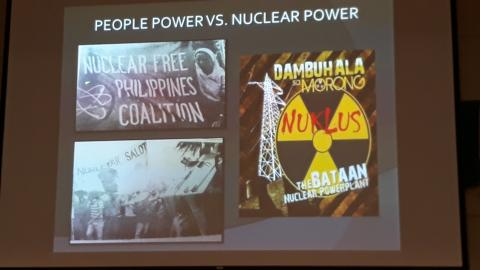 "A screen from a presentation that says ""People power vs nuclear power"" with three pictures of people protesting"
