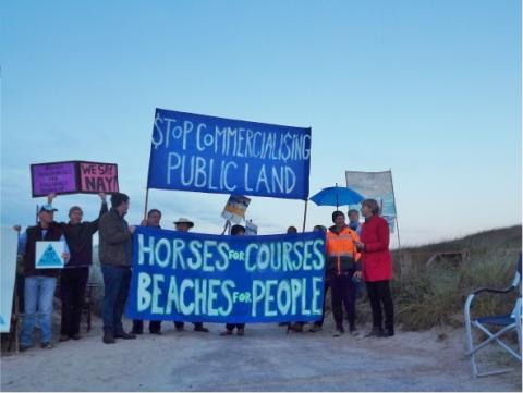 Greens Senator Janet Rice speaks to a demonstration at Killarney Beach against use of Public Places being dominated by commerical interest